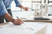 Construction Concept, Hands Of Architect Or Engineer Working For New Project Plan On Blueprint, Mode poster