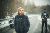 Retro Woman In Coat On Road. Couple In Love On Romantic Date. Bearded Man And Sexy Woman In Fur Coat poster