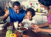Black family eating healthy food together poster