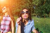 Happy Friends In The Park On A Sunny Day . Summer Lifestyle Portrait Of Three Hipster Women Enjoy Ni poster