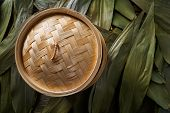 Asian kitchen bamboo steamer for steam cooking recipes on leafs poster