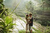 Young Latin American Couple With Amazing View Of Ubud Rice Terraces In Morning. Happy Together, Hone poster
