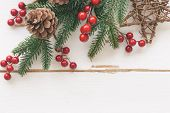 White Wood With Pine Leaf, Pine Cones Or Conifer Cone, Holly Balls, Star, Candy Cane And Bauble In C poster