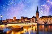 fireworks over Zurich city center with famous Fraumunster and Grossmunster Churches and river Limmat poster
