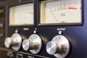 Close up macro photograph of analogue UV sound volume meter and control dials in a rcording studio o poster