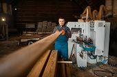 Carpenter works on woodworking machine, lumber poster