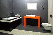 picture of lavabo  - Contemporary black bathroom with orange wash basin - JPG