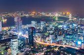 Tokyo, Japan over Tokyo Bay at night. poster