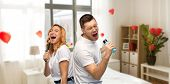 valentines day, fun and people concept - portrait of happy couple in white t-shirts couple singing  poster