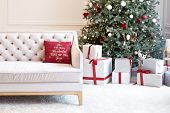 Living Room Interior With Sofa, Christmas Tree, Gifts And Pillows. Modern Minimalist Living Room Int poster