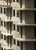 Gray Walls Of Apartment Buildings Under Construction. High-rise Apartment Buildings Under Constructi poster