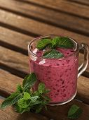 Blackcurrant Smoothie With Banana And Mint In A Glass Cup. Smoothie Decorated With Mint Leaves, A Gl poster