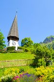 Beautiful Protestant Church In Alpine Village Wengen, Switzerland Photographed In The Summer With Gr poster