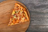 Slice Of Pizza On A Wooden Background. A Slice Of Pizza. Top View Of A Slice Of Pizza. From An Empty poster