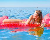 foto of nudism  - Nude on red mattress - JPG