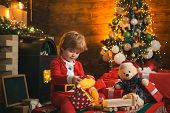 Check Contents Of Christmas Stocking. Christmas Eve. Happy Holiday. Holiday. Xmas Tree. Child At Chr poster