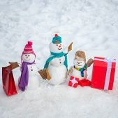 Snowmen Family - Gift Presents Concept. Winter Sale Banner. New Year Gift. Santa Claus Gifting Gift. poster