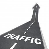 The word Traffic on a road rising up to represent increased activity on the web or transportation sy