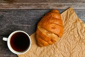 Morning With A Croissant. The Beginning Of The Morning. Fresh French Croissant. Coffee Cup And Fresh poster