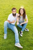 Summer Vacation. Couple Dating. Carefree Couple Having Fun Green Lawn. Man And Pretty Woman Cheerful poster
