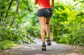 Runner running legs from the back jogging on nature path outside. Running shoes girl training cardio poster
