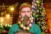Christmas Holiday. Serious Bearded Santa Man With Decorated Beard. New Year Party. Christmas Beard D poster