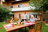 pic of nic  - Family having a barbecue in the garden - JPG