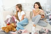 Happy Childhood. Pajamas Party. Sisters Sharing Toys. Sisters Best Friends. Kids Play Toys In Bed. L poster