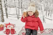 Happy Child Girl On Winter Walk Outdoors Drinking Tea. Smiling Baby Little Child Playing In Winter C poster