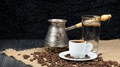 Hot Coffee In Turkish Cooper And Linen Table. Greek Coffee Pot, Glass Of Water And Coffee Beans Drop poster