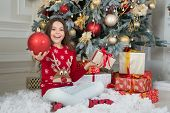 Experience Beauty Of Christmas Season. Happy Child Hold Glossy Red Ball Decoration. Christmas Tree D poster