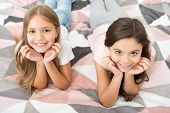 There Are Many Reasons To Be Happy. Happy Kids With Cute Smiles. Small Children Relax On Bed. Enjoyi poster