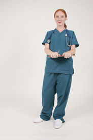 stock photo of medical assistant  - nurse or medical assistant holding a patient record on a clipboard - JPG