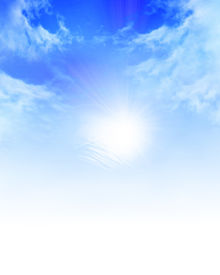 foto of sun rays  - sunlight in a clear blue sky with some clouds - JPG