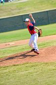 stock photo of little-league  - Little league baseball pitcher throwing the ball - JPG