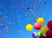 image of levitation  - multicolored balloons and confetti in the city festival  - JPG