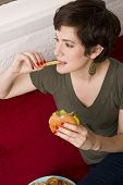 Woman Eating Burger Fries Lunch Sofa Living Room Meal Time