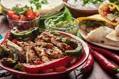 traditional mexican food: cilantro and lime rice, chicken fajitas, fajita peppers, burritos, tortill