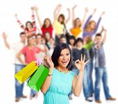 foto of boxing day  - Woman with shopping bags over people group background - JPG