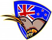 image of angry bird  - Illustration of an angry kiwi bird head viewed from side with New Zealand flag in background set inside crest shield done in retro style - JPG