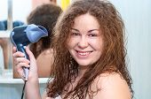 Excited Caucasian Woman Drying Her Hairs With Hairdryer
