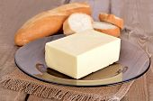 stock photo of margarine  - Butter and bread on old wooden table - JPG