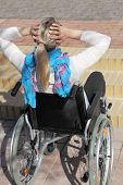 picture of physically handicapped  - A young female Wheelchair user in front of a stair - JPG