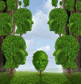foto of nurture  - Community assistance and public support concept as a group of adult human head shaped trees giving help to a young child plant as a nurturing metaphor for government social services in education and friendship - JPG