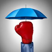 stock photo of safeguard  - Competition protection business concept with a red boxing glove from a businessman with a blue umbrella symbol protecting as a defense and buffer safeguard for risk and financial uncertainty - JPG