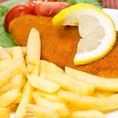 stock photo of wieners  - wiener schnitzel with french fries close up  - JPG