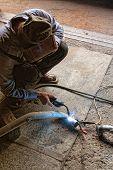 pic of exhaust pipes  - The welder behind work - JPG