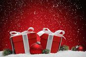 image of gift wrapped  - Christmas gift box and balls on snow - JPG