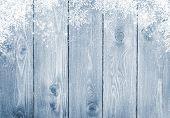 picture of frozen  - Blue wood texture with snow christmas background - JPG