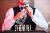 picture of bartender  - Bartender is making cocktail at bar counter